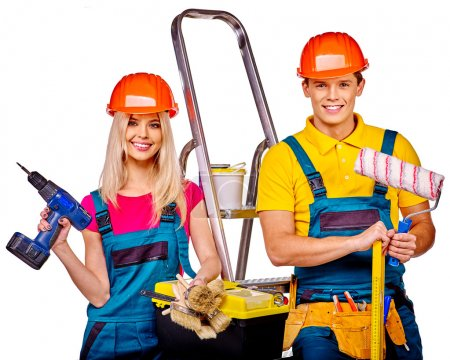 Couple builders  with construction tools.