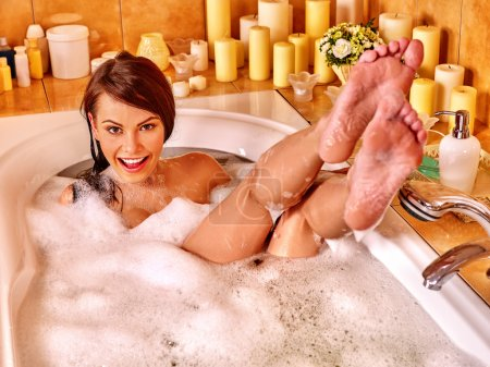 Woman relaxing at  bubble bath.