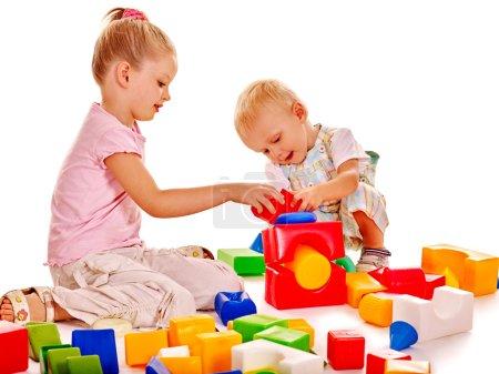Children play building blocks.