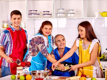 Happy senior family cooking at kitchen.