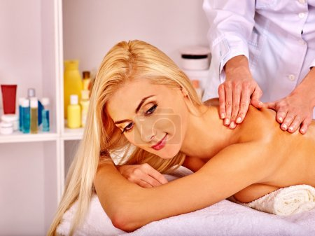 Photo for Blond woman getting massage in health resort. - Royalty Free Image