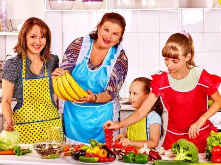 Happy family cooks at kitchen.