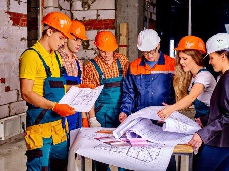 Business group people in builder helmets