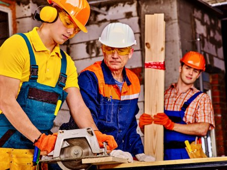 Group people  builder with circular saw