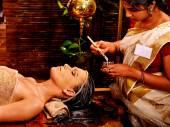 Woman having gluemask at ayurveda spa.