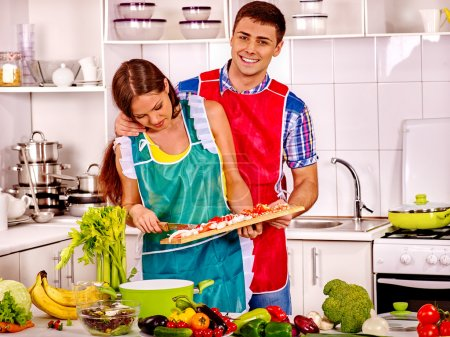 Photo for Couple cooking dinner at kitchen. - Royalty Free Image