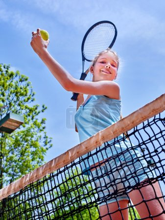 Sports girl with racket and ball
