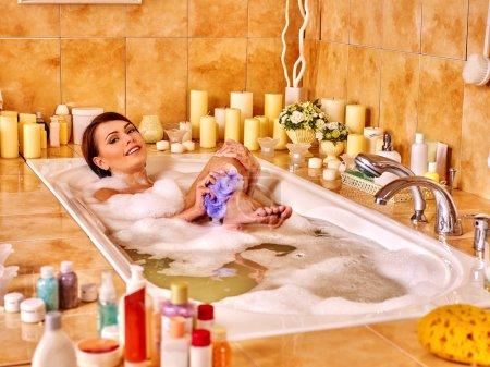 woman washing leg