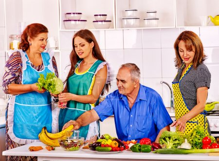 Family  cooking at kitchen.