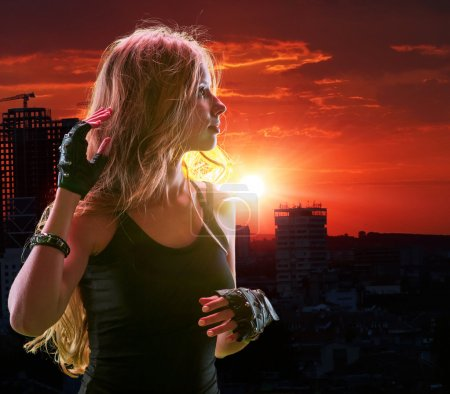 Photo for Teen girl in city looking sunset. Urban style - Royalty Free Image