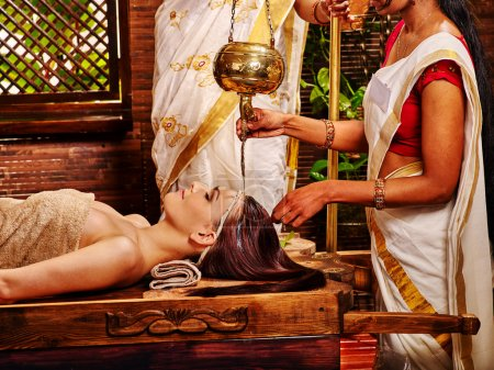 Photo for Young woman having Ayurveda spa treatment. - Royalty Free Image