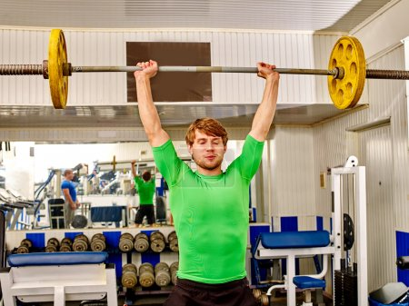 Man working with dumbbells at gym