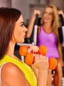 girl holding dumbbells