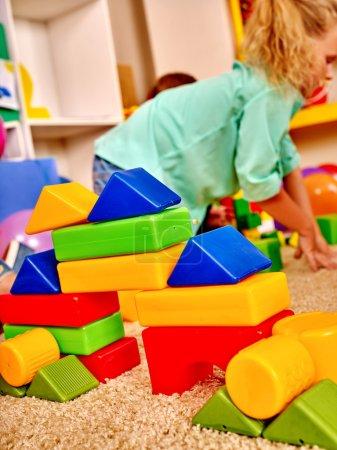 Girl game blocks on floor