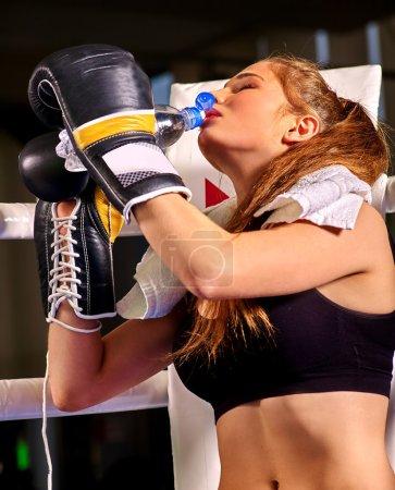 Girl boxer drinking water