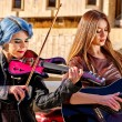 Постер, плакат: Music street performers two girls