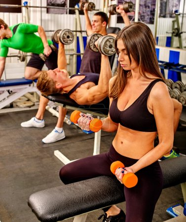 people working with dumbbells