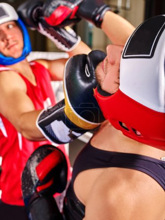 Two  men boxer wearing helmet  boxing .