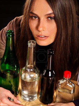 Drunk girl holding bottle of vodka.