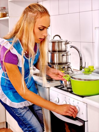 Photo for Young mistress woman cooking at kitchen - Royalty Free Image