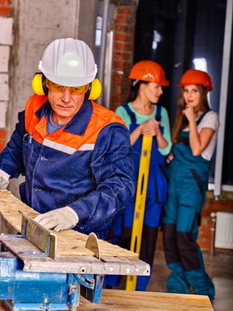Group people  builder hard working with circular s...