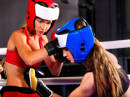 women boxers wearing helmets