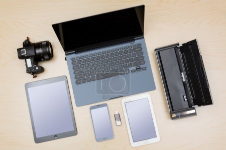 Photo for Overhead view of many computing and smartphone screens to illustrate the concept of responsive design or template - Royalty Free Image