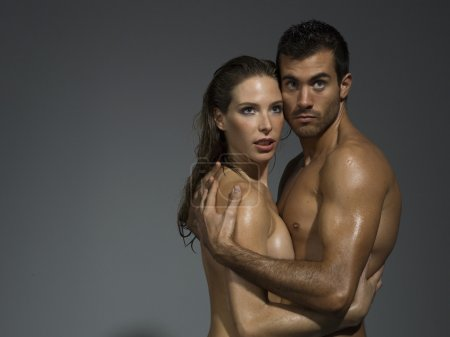 nude couple in love over grey blackground