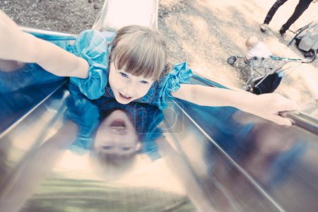 Little Girl Playing on Slide