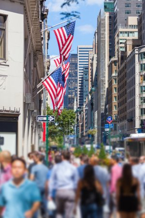 Photo for Crowded Sidewalk in New York and United States Flags - Royalty Free Image