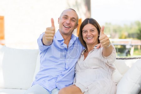 Photo for Mature Couple Showing Thumbs Up - Royalty Free Image