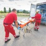 Rescue Team Providing First Aid...