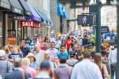 NEW YORK, USA - AUGUST 28, 2014: Crowded sidewalk on 5th Avenue