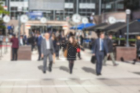 Commuters in Canary Wharf, financial district of London, blurred
