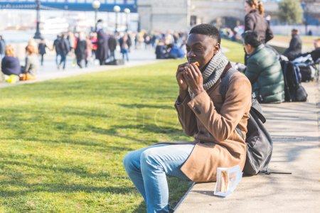 Young man having lunch break in London