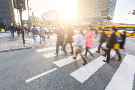 Blurred crowd of people walking on zebra crossin in Copenhagen