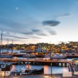 Oslo harbour with boats and yachts at twilight. Th...