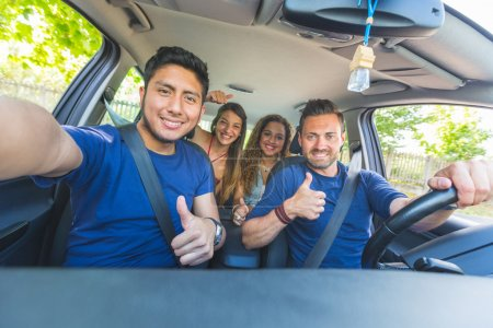Group of friends taking a selfie into the car