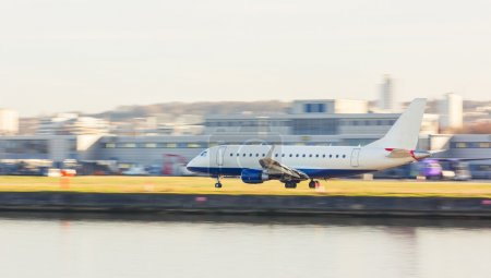 Panning view of an airplane taking off or landing