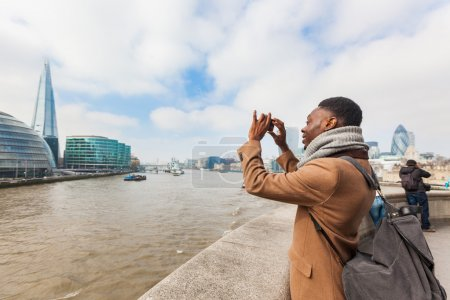 Man taking a picture in London with his smart phone