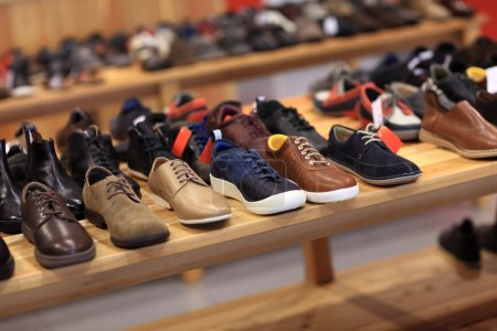Photo for Shoes on the wooden shelf in the store - Royalty Free Image