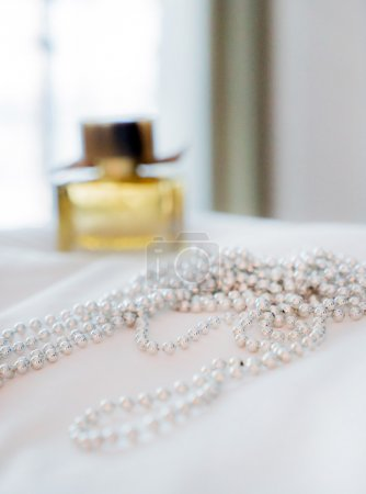 Pearl necklace on bed
