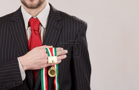 Successful businessman with medal