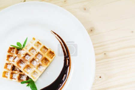 waffle with chocolate on  plate