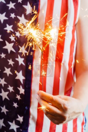 woman in usa bloose with sparkler