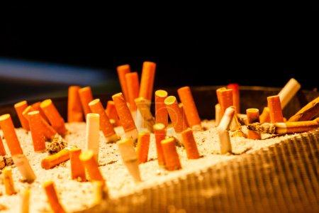 Ashtray and cigarettes closeup