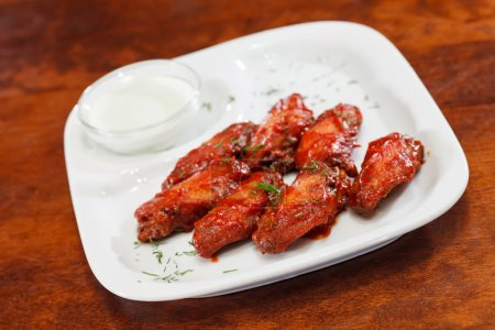 Chicken wings with sauce