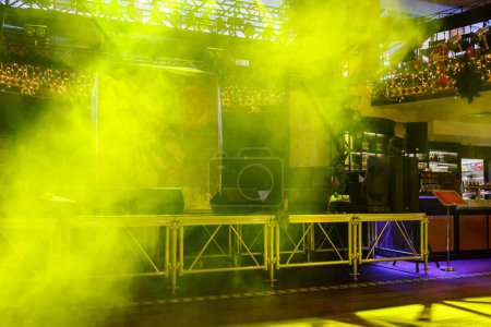 Photo for Concert stage with smoke in green lights - Royalty Free Image