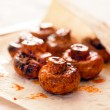 Grilled mushrooms closeup on white plate...
