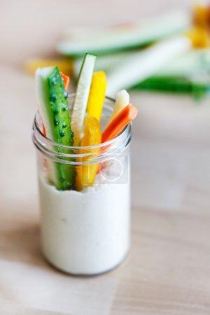 Hummus with vegetables in jar